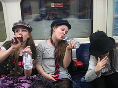 young women enjoying the hell out of mass transit